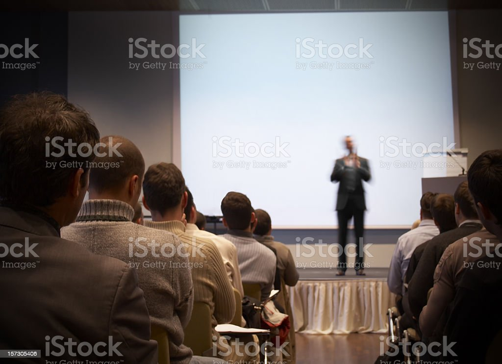 Business conference in a hall with white screen stock photo