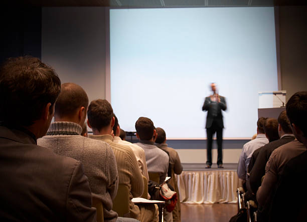 business conference in a hall with white screen - awards ceremony stock photos and pictures