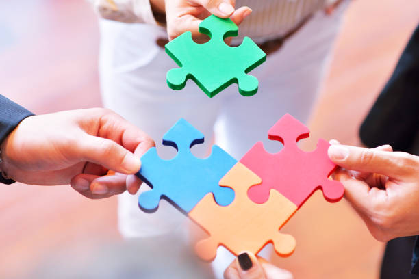 business connection corporate team jigsaw puzzle concept - puzzle foto e immagini stock