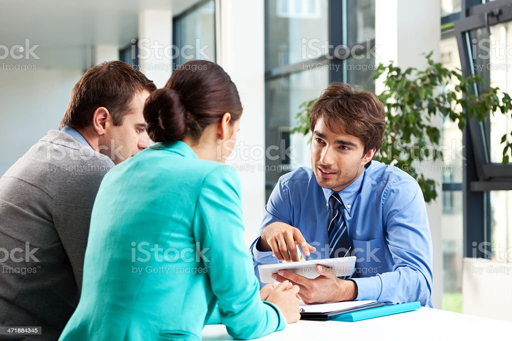 Adult couple having meeting with business consultant.