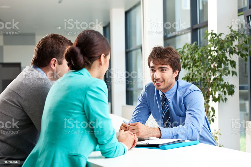 Business consulting Adult couple having meeting with business consultant.  Adult Stock Photo