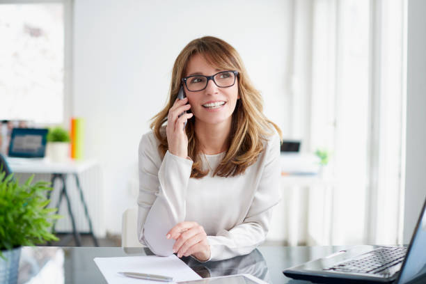 business conversation - older woman phone stock photos and pictures
