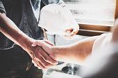 Business Cooperation, Construction, Design agreement concept. Handshake between designer engineers
