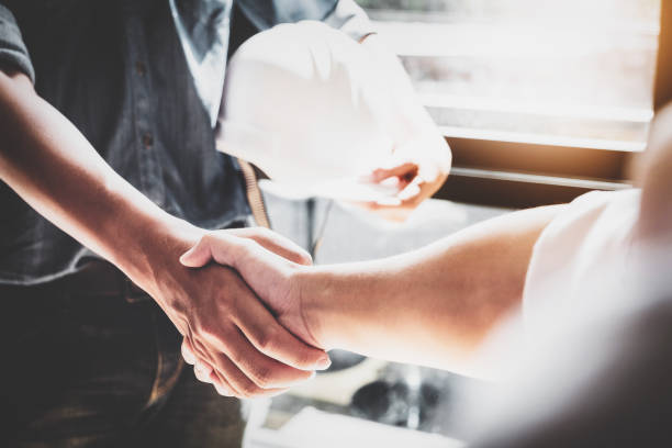 business cooperation, construction, design agreement concept. handshake between designer engineers - handshake stock pictures, royalty-free photos & images