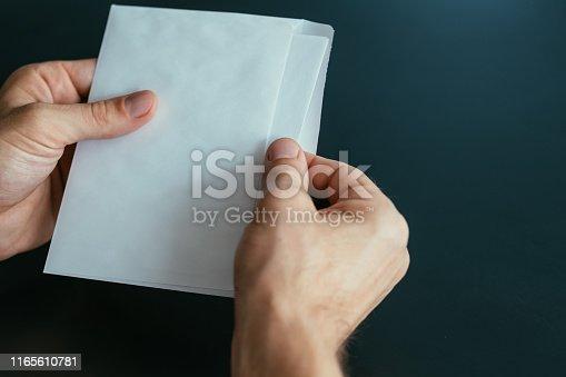 istock business correspondence man envelope letter 1165610781
