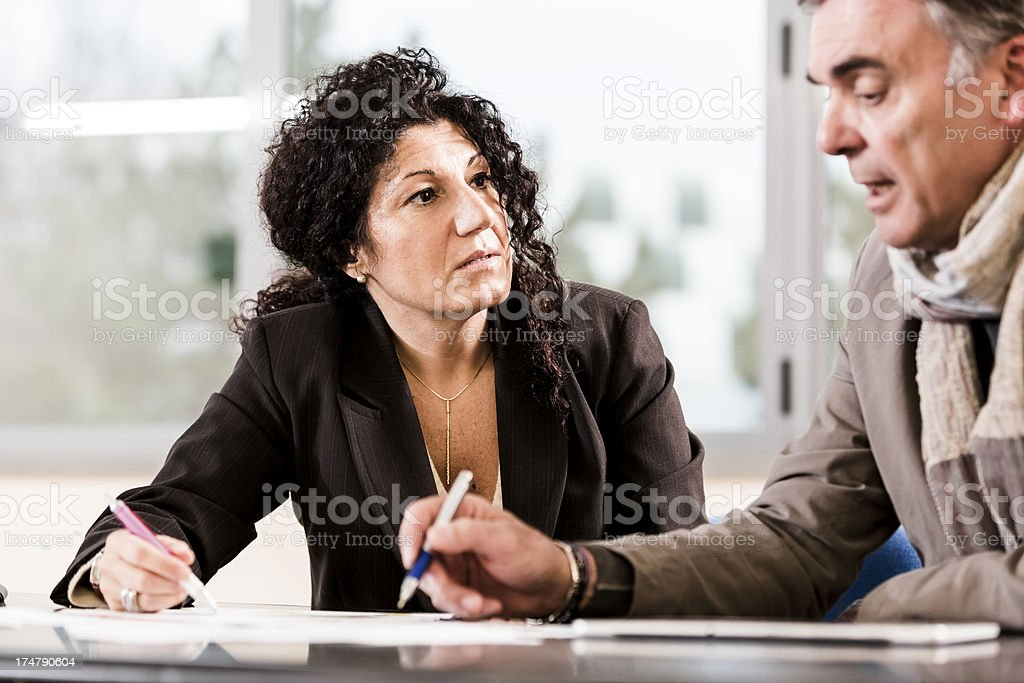 Business couple are analyzing market situation royalty-free stock photo
