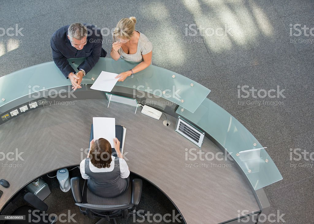 Business couple At Hotel Reception stock photo