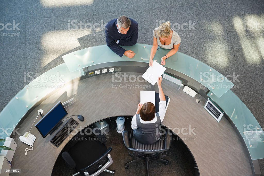 Business Couple At Reception Desk stock photo