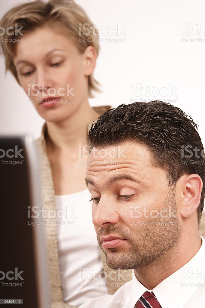 Business couple at work with laptop royalty-free stock photo