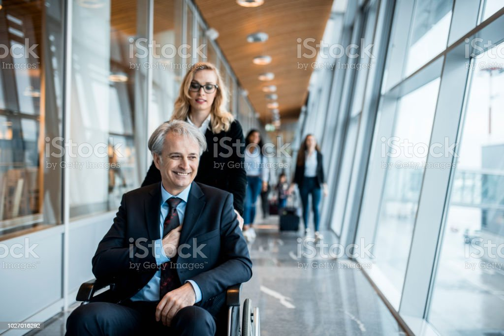 Business couple boarding a plane stock photo