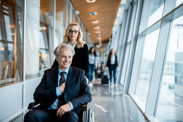 business couple boarding a plane - leaving partnership corporate business sitting stock photos and pictures