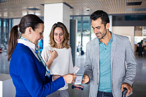 business couple boarding to plane at airport - airport check in counter stock pictures, royalty-free photos & images