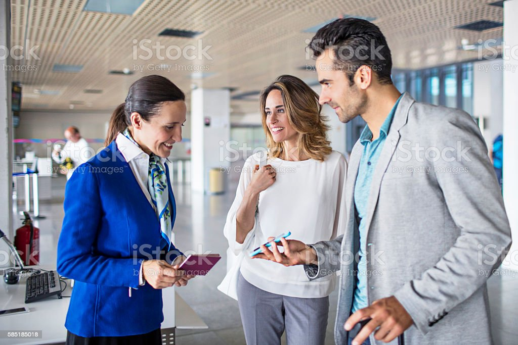 Business couple boarding to plane at airport stock photo