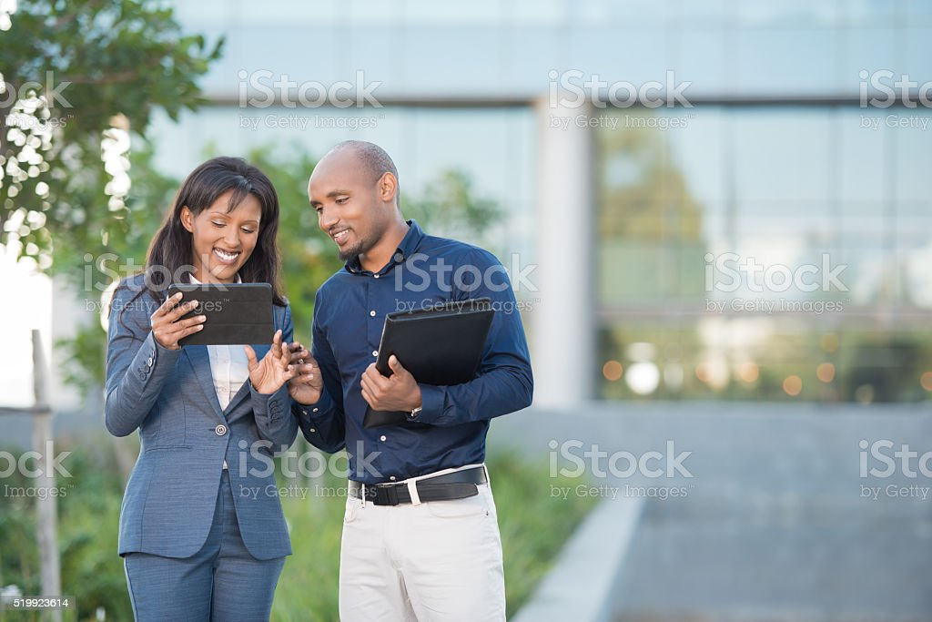 Business couple chatting online. stock photo