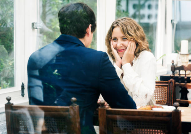 business couple dating in the cafe - dating stock photos and pictures