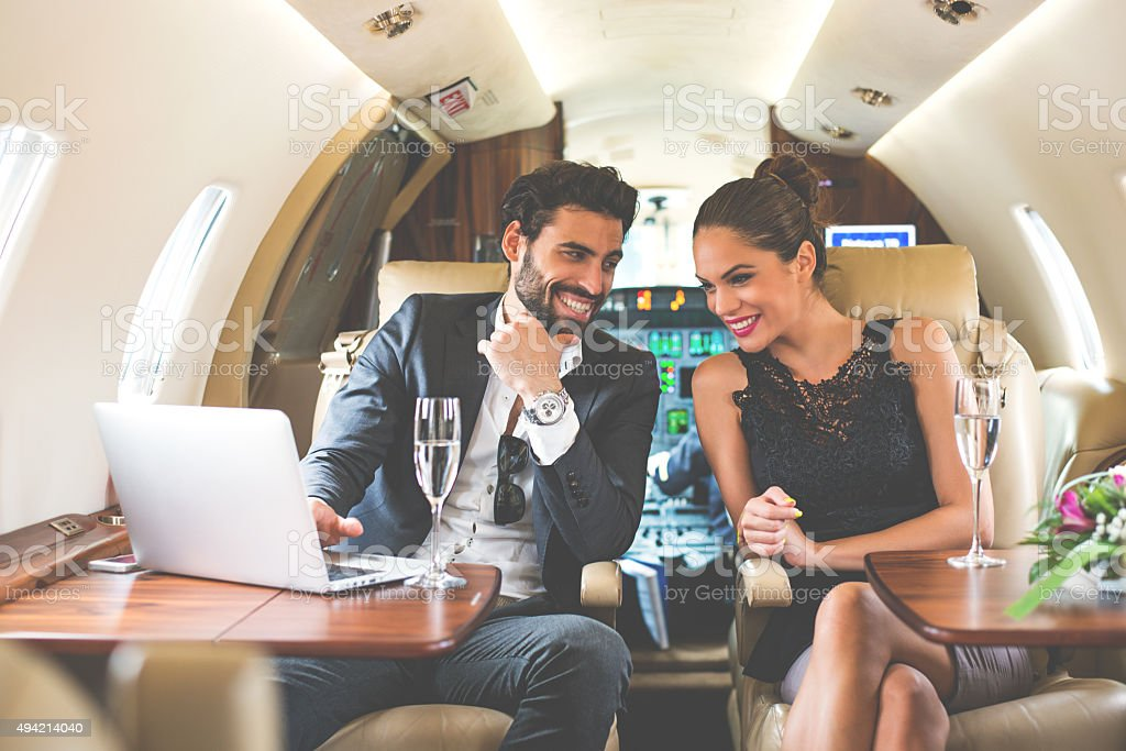 Business couple enjoying in private aeroplane stock photo