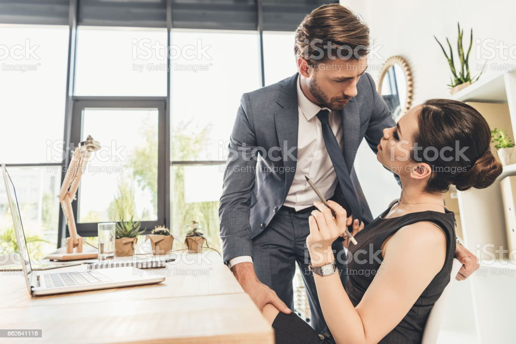 Business couple flirting stock photo