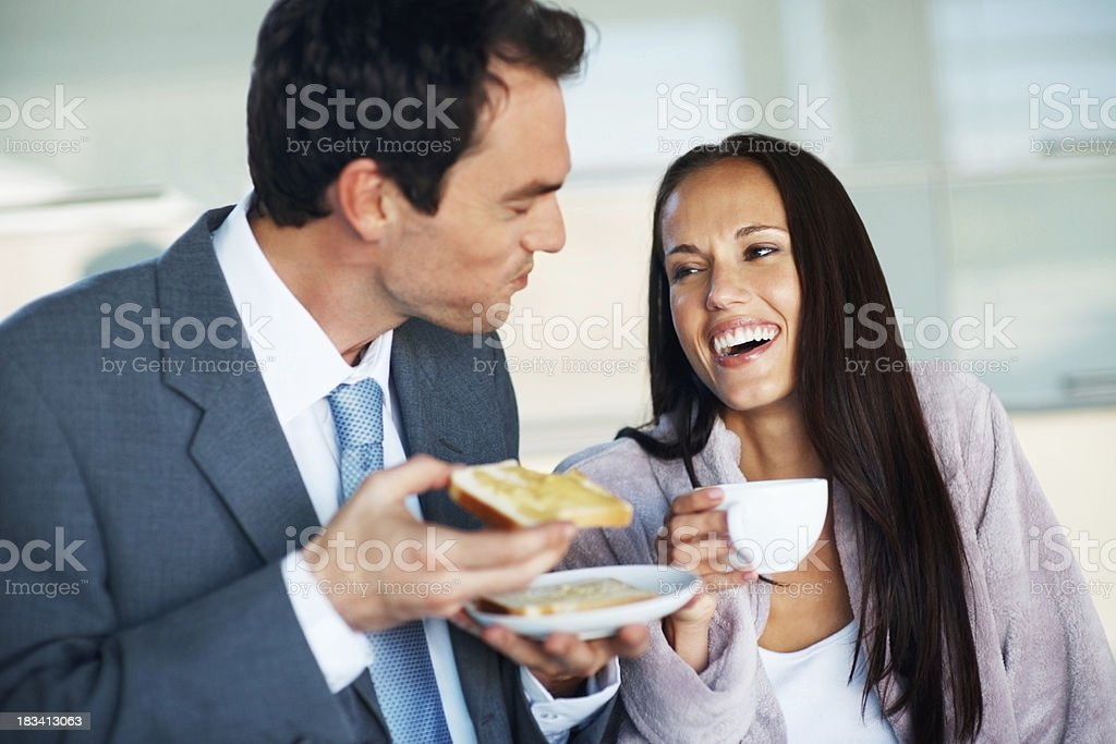 Business couple having breakfast royalty-free stock photo