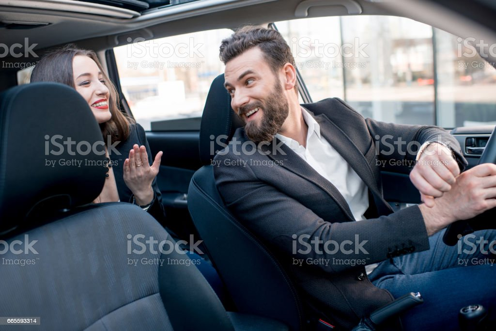 Business couple in the car stock photo