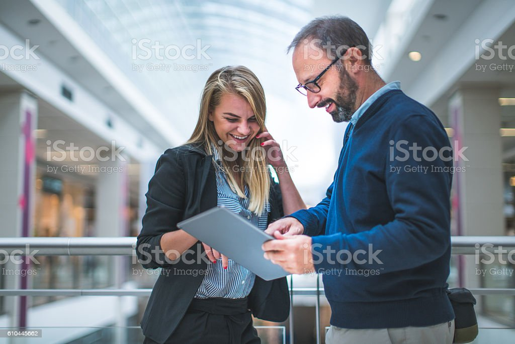 Business couple in the mall - Royalty-free Adult Stock Photo