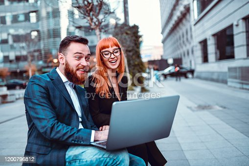 Business Couple Laughing At Theoretical Project Mistake They Made