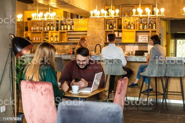 Business couple on meeting in cafe picture id1147579054?b=1&k=6&m=1147579054&s=612x612&h=spsswkxj2jymsjsnslehbw8cb8rzviiihp5ohn3wmfi=