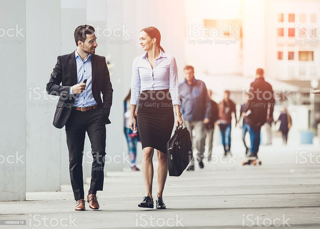 Business couple outdoors meeting stock photo