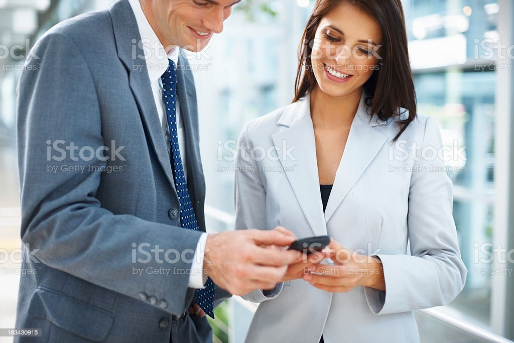 Business couple reading text message royalty-free stock photo