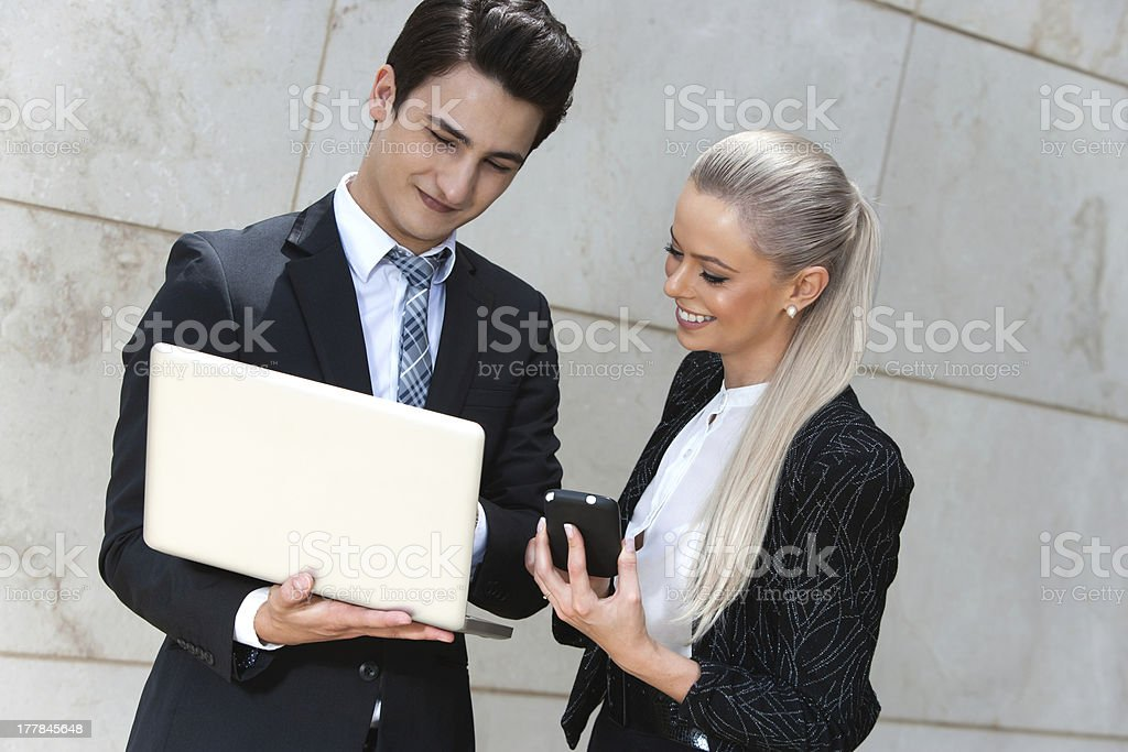 Business couple reviewing data. royalty-free stock photo
