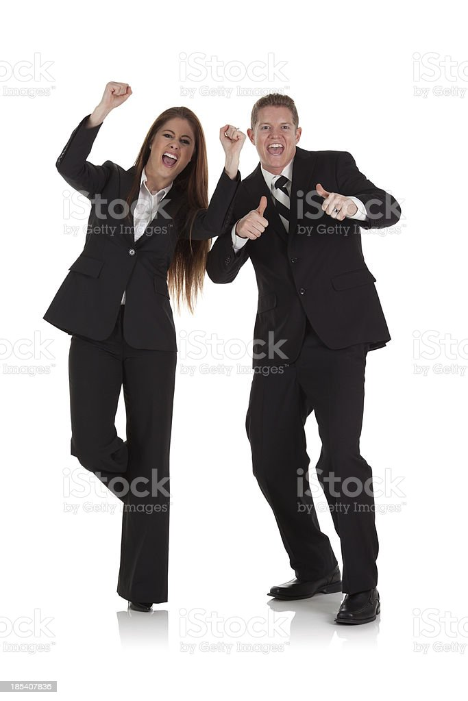 Business couple shouting in excitement stock photo
