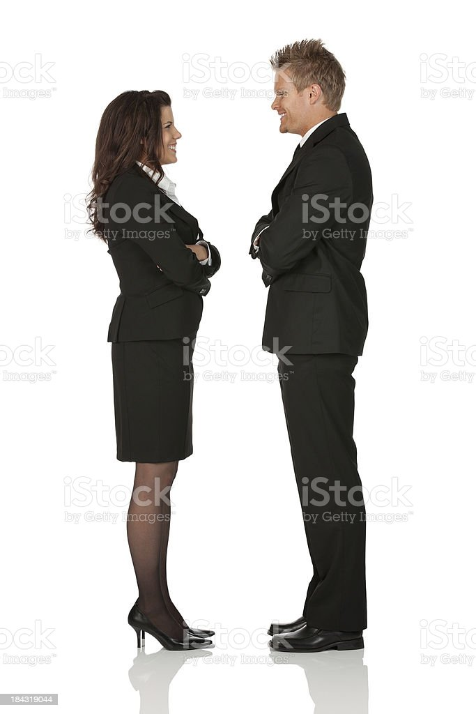 Business couple smiling at each other royalty-free stock photo