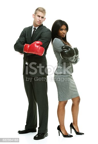istock Business couple standing & looking at camera 532354163