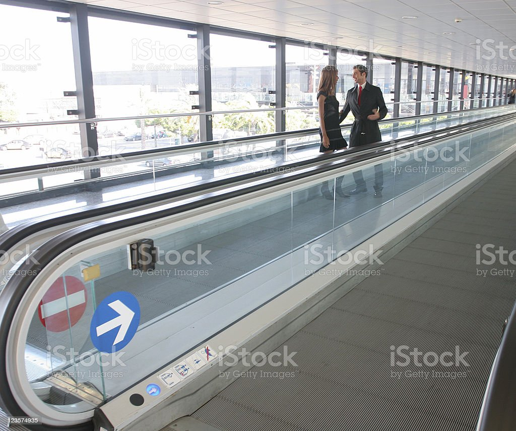 Business couple talking at the airport stock photo
