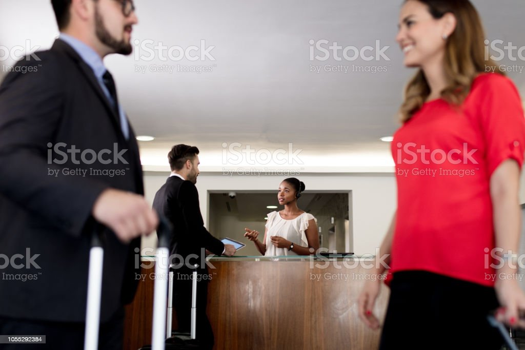 Business couple talking in lobby stock photo