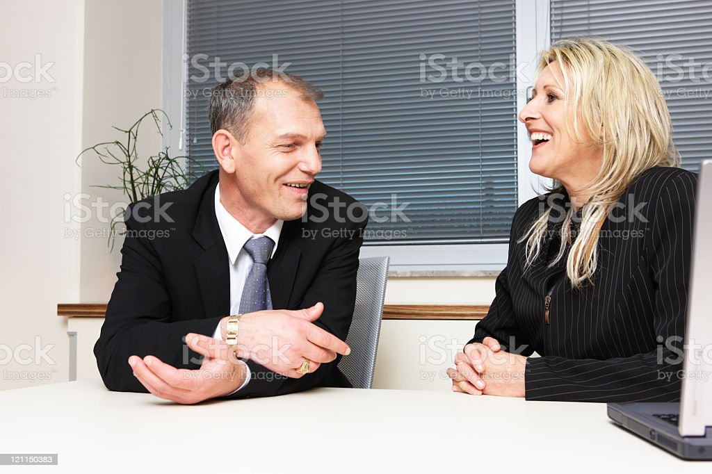 Business couple talking in the office stock photo