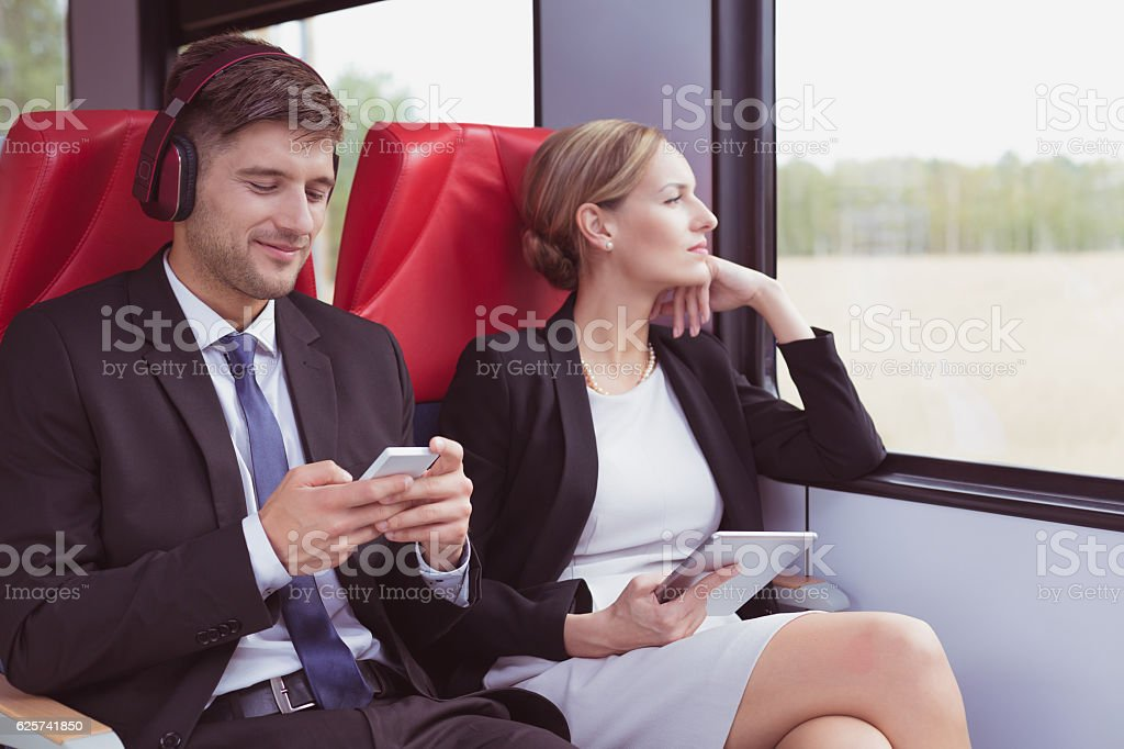 Business couple traveling to work stock photo
