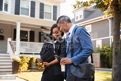 istock Business Couple With Baby Son Leaving House For Work 904480182