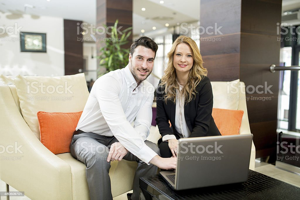 Business Couple with Laptop royalty-free stock photo