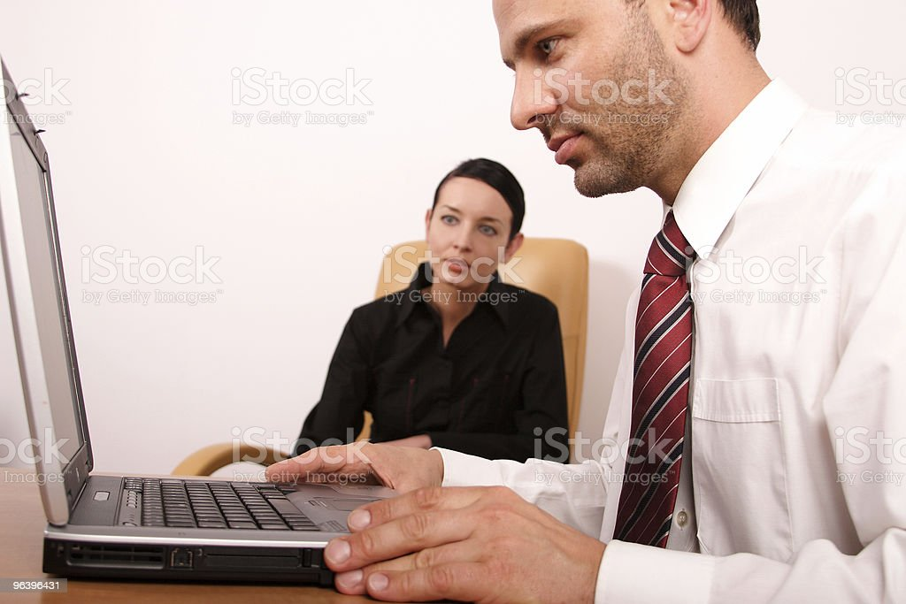Business couple working in the office royalty-free stock photo