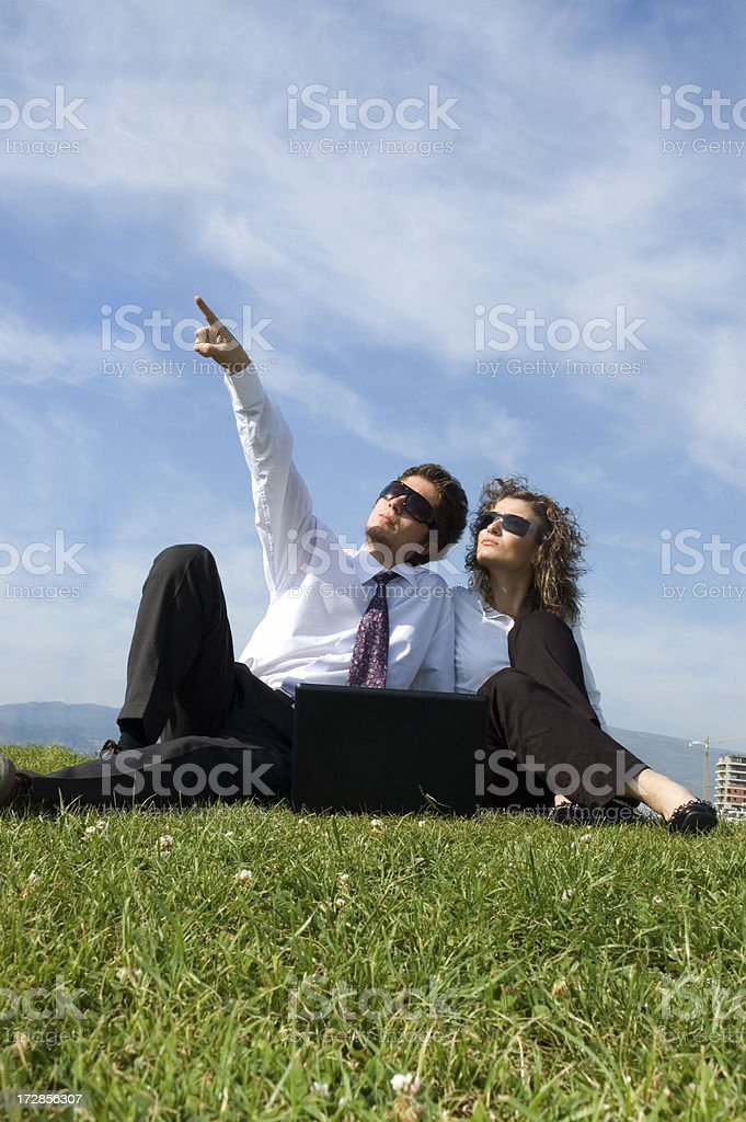 business couple working on grass royalty-free stock photo