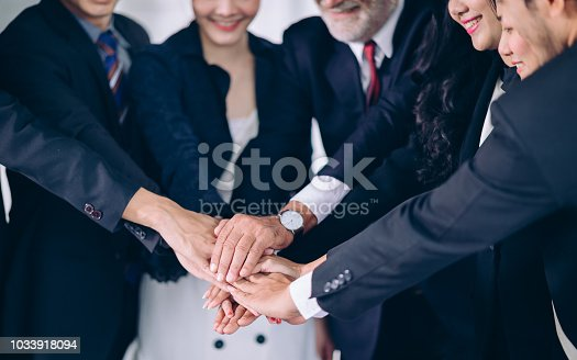 905746192 istock photo Business Cowerkers Teamwork join hands support together.Successful Teamwork Partnership at office 1033918094