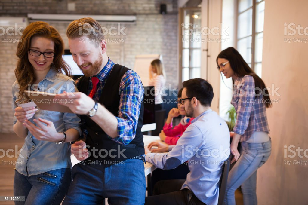 Business coworkers celebrate achieved goals in office royalty-free stock photo