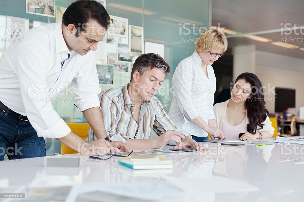Business coworkers collaborating at conference table in planning studio – Foto