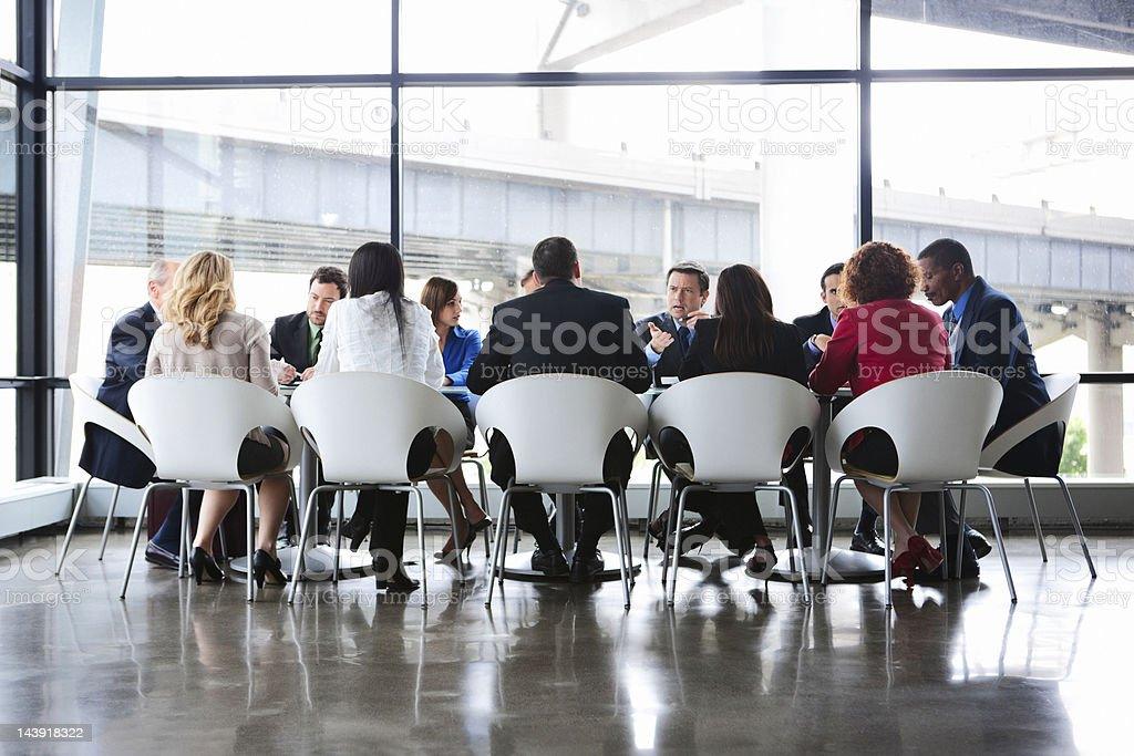 Business Coworkers Meeting at Large Conference Table in Glass Office royalty-free stock photo