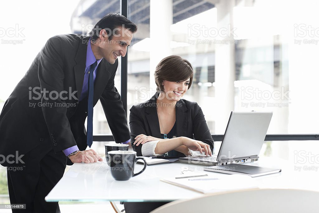 Business Coworkers Using Laptop During Meeting in Glass Office, Copyspace royalty-free stock photo