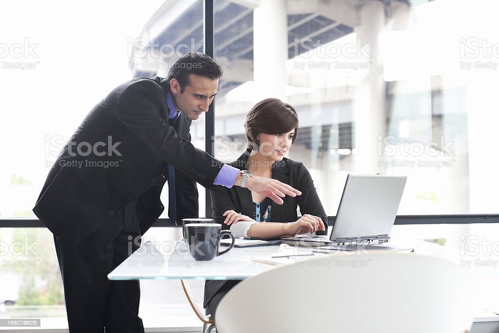 Business Coworkers Using Laptop During Meeting in Glass Office royalty-free stock photo