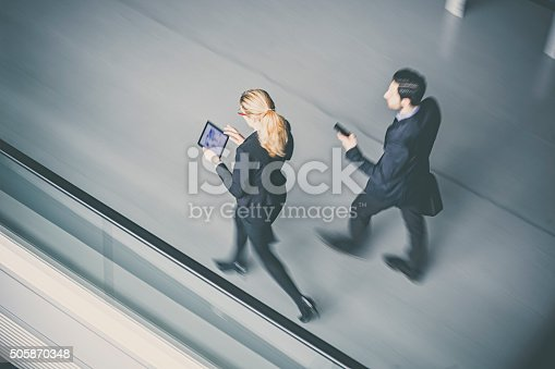 905689676 istock photo Business coworkers  walking together in office building 505870348
