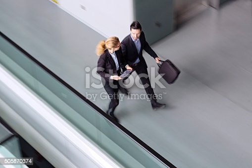 905689676 istock photo Business coworkers  walking together in office building 505870374