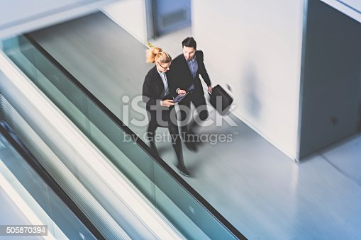 905689676 istock photo Business coworkers  walking together in office building 505870394