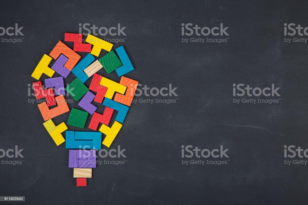 Business creative solution concept jigsaw on the blackboard stock photo